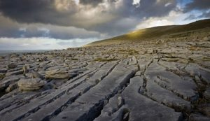 Day Trips 1 Shannon Airport Taxis recommends viewing the landscape of The Burren as photographed by Cliffs of Moher Tourism